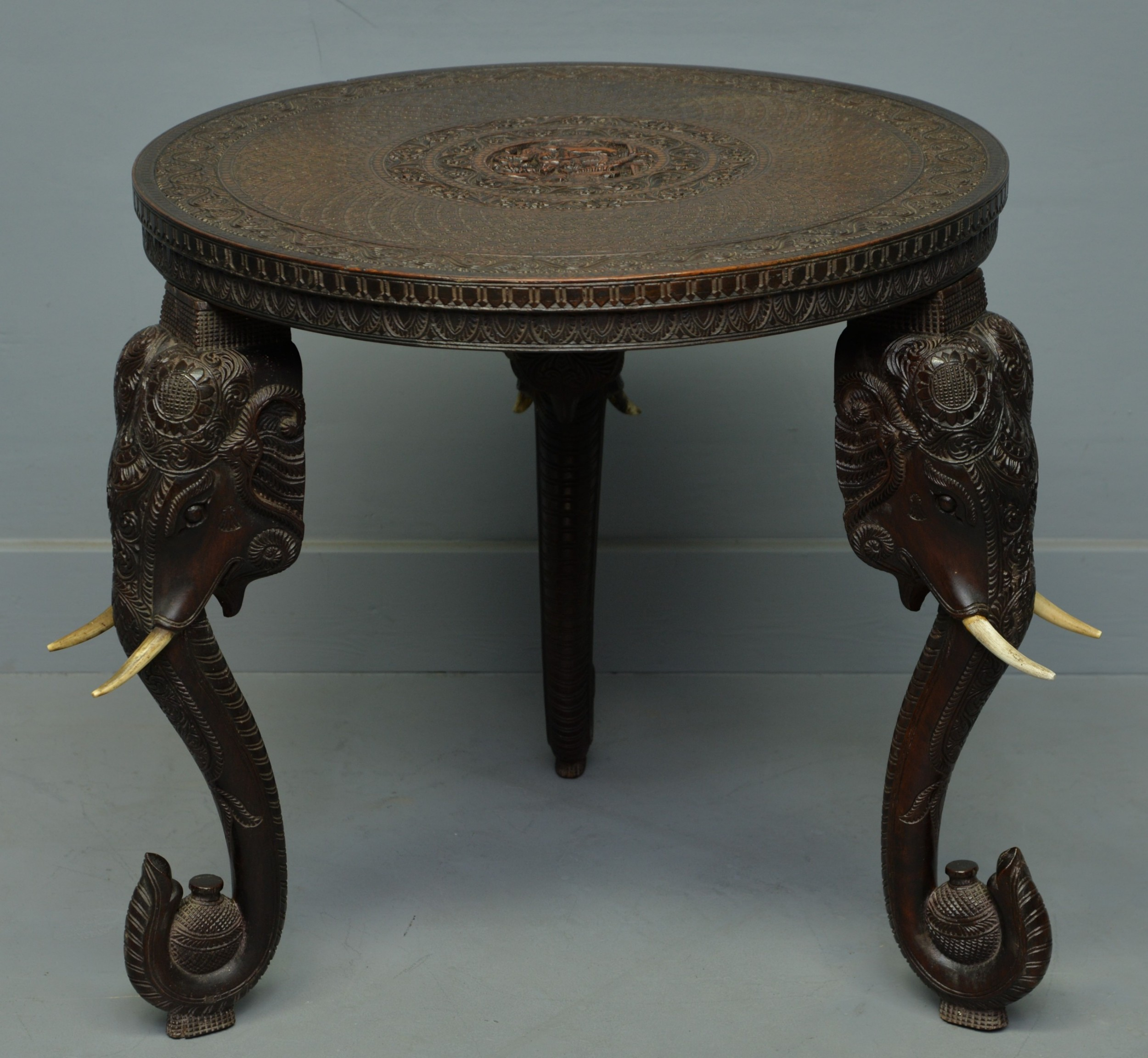 indian rosewood carved elephants head occasional table