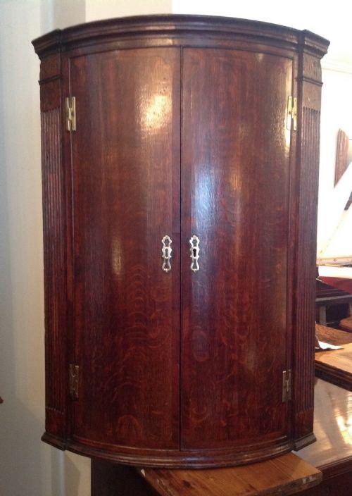18th century bowfront corner cupboard