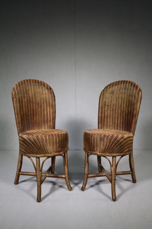 pair of 1930's lloyd loom chairs dated 1934