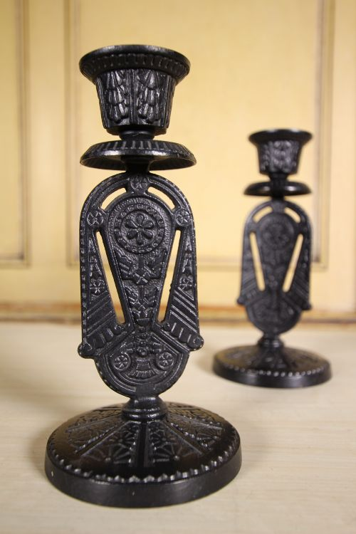 pair of aesthetic antique iron candlesticksvery dresser