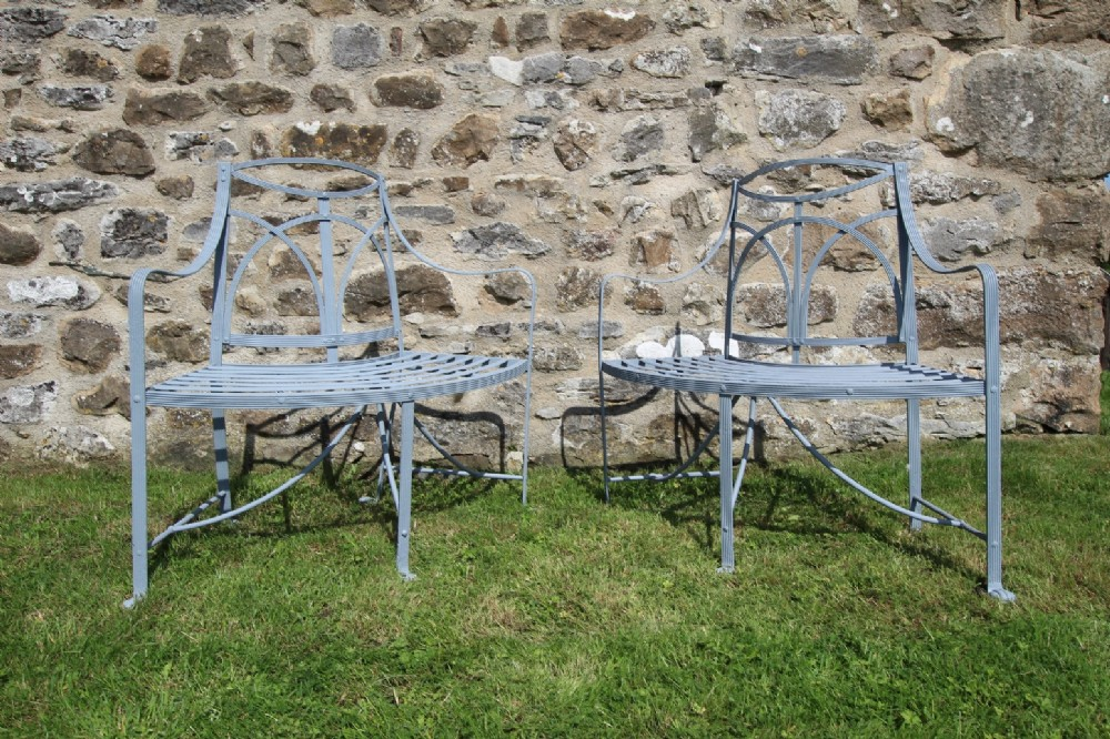 wonderful original pair of regency antique iron garden seats