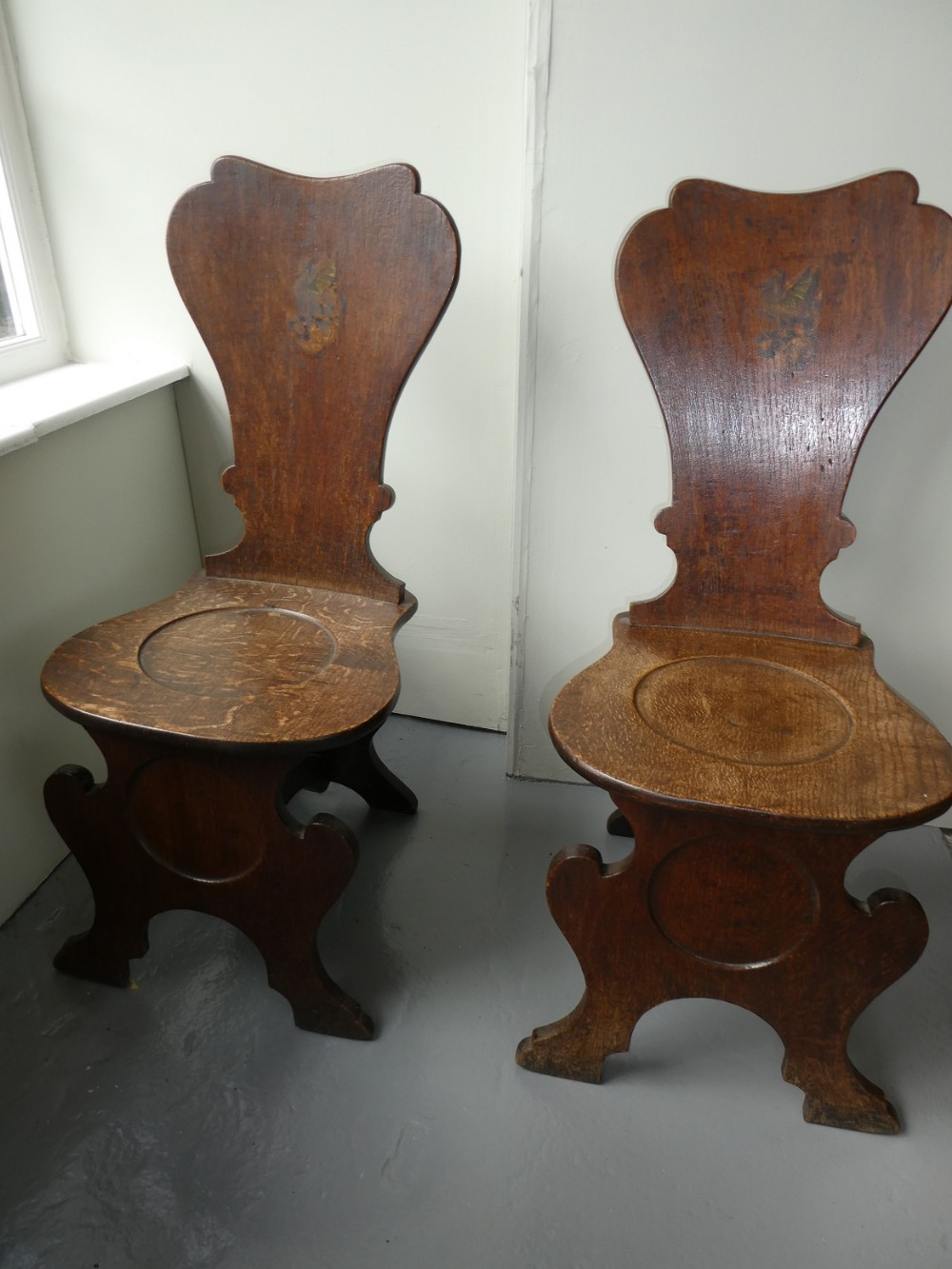 pair of english 18thc oak hall chairs