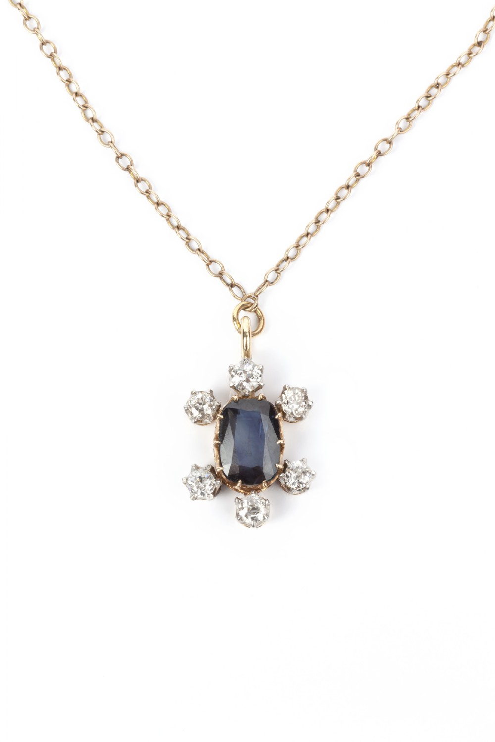 a natural unheated sapphire and old cut 06ct diamond pendant