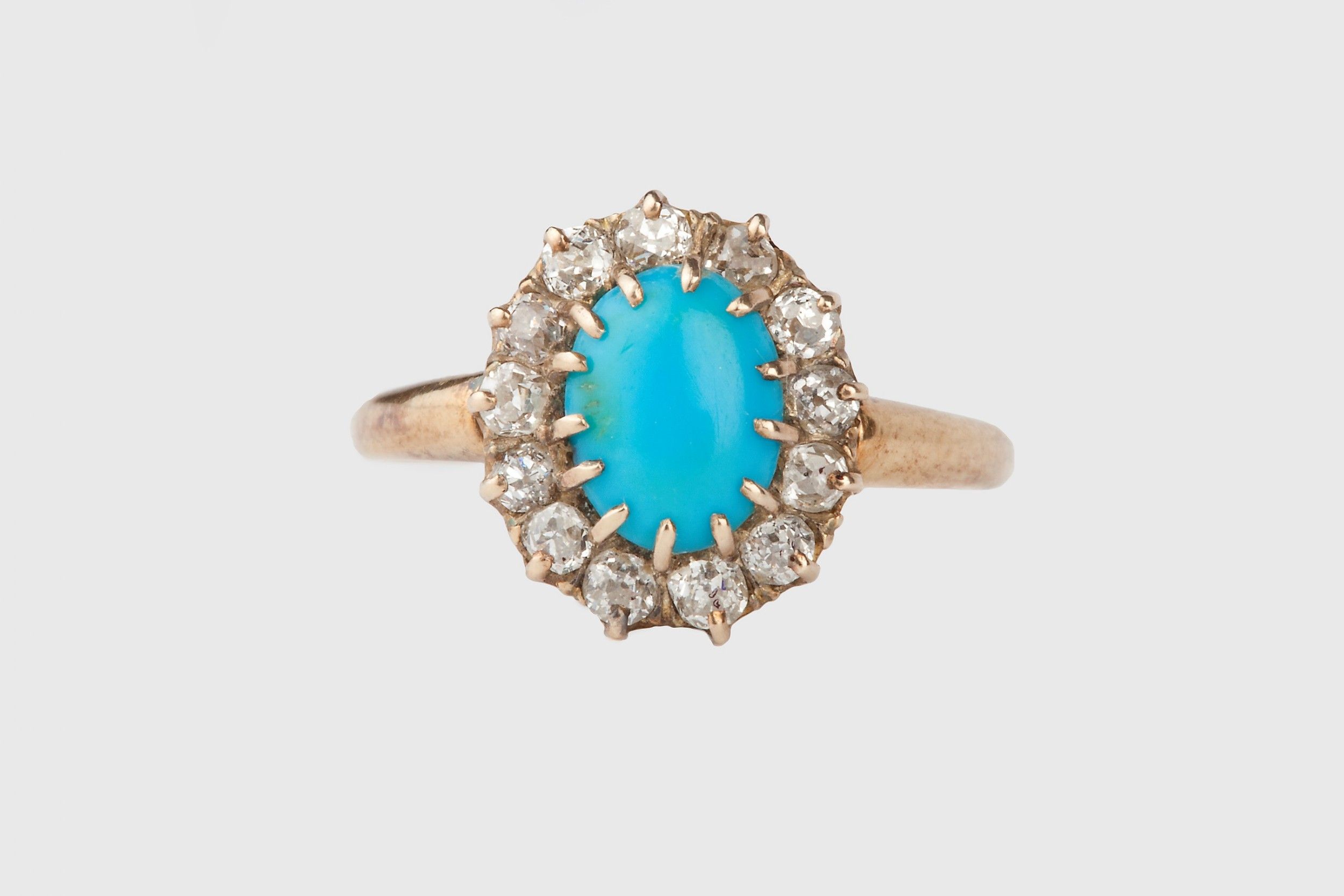 a diamond and turquoise victorian ring