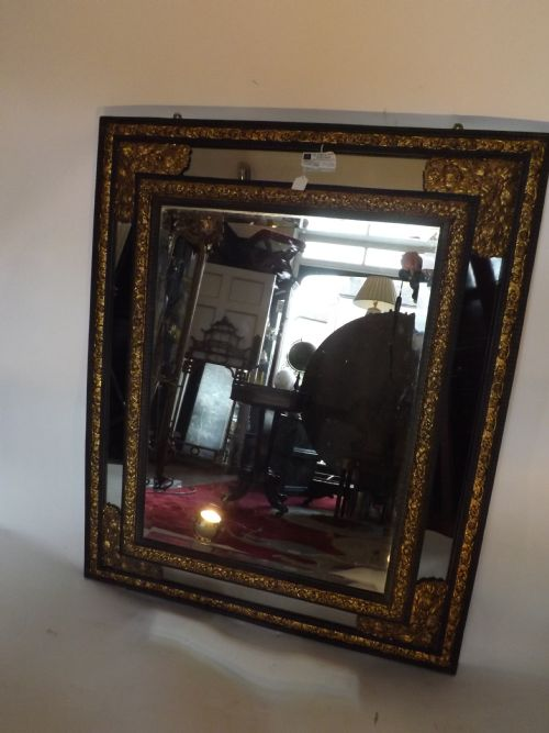 c19th flemish ebonised 'cushion' mirror