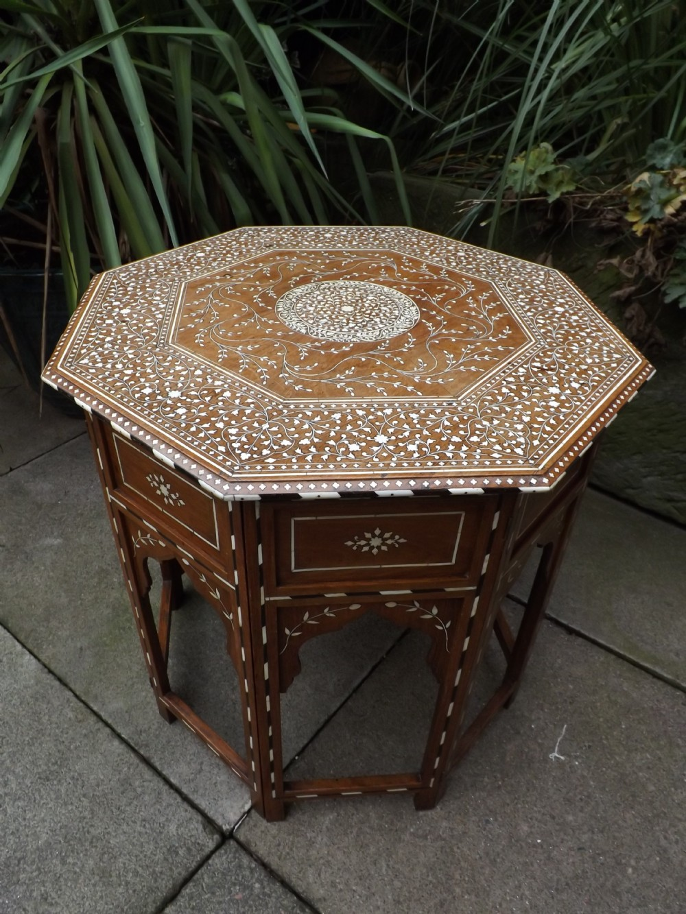 late c19th indian ivoryinlaid 'shisham'indian rosewood octagonal table on hinged folding base
