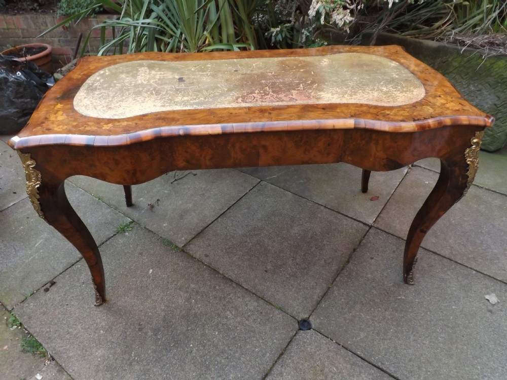 c19th burrwalnut and floral marquetry inlaid ormolumounted 'bureau plat' or writing table