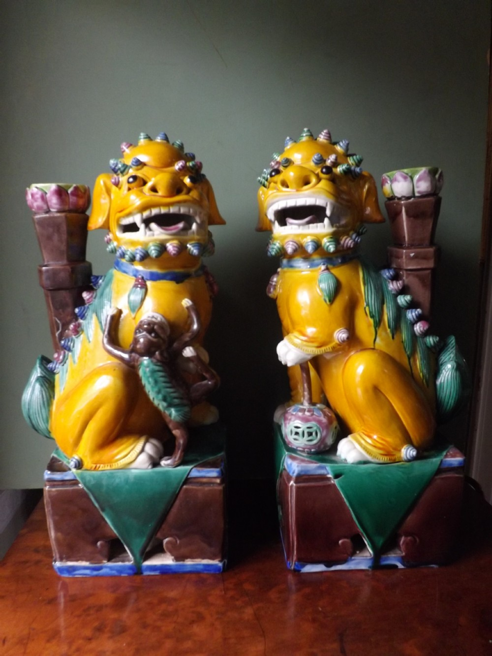 pair of early c20th chinese glazed pottery 'dogs of fo'