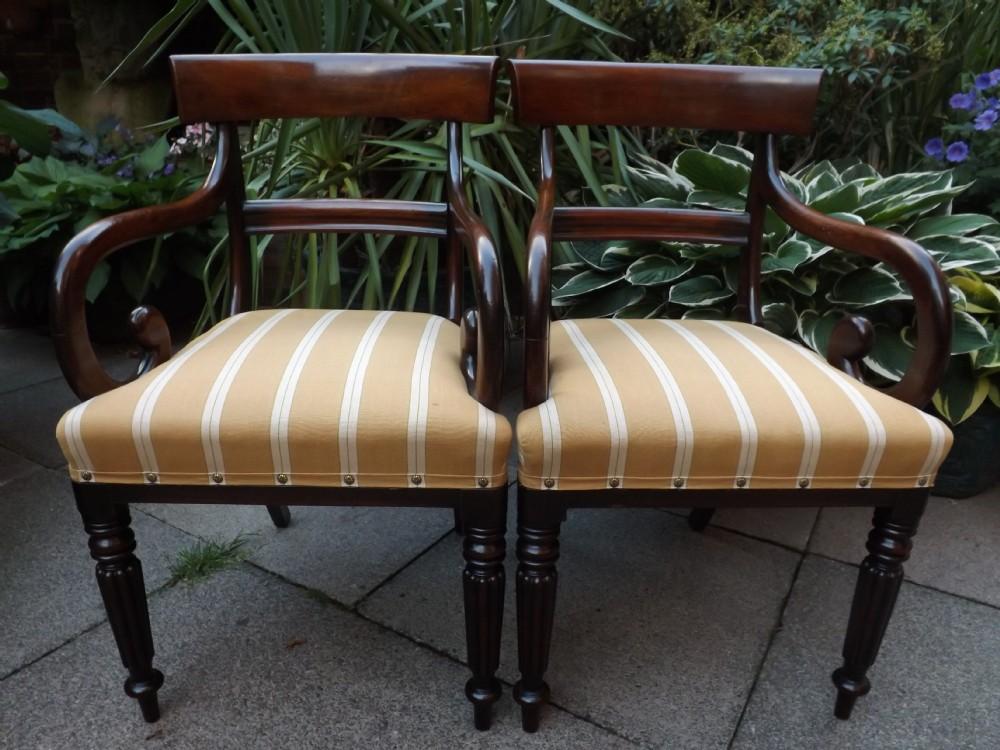 pair of early c19th regency mahogany armchairs