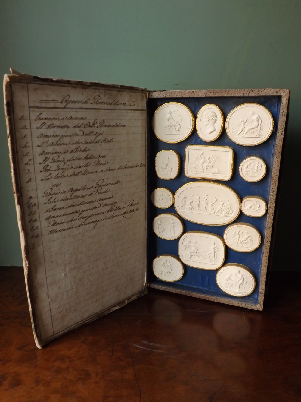 c19th italian 'grand tour' souvenir faux book volume containing series of plaster intaglios of the works of bertel thorvaldsen by paoletti rome