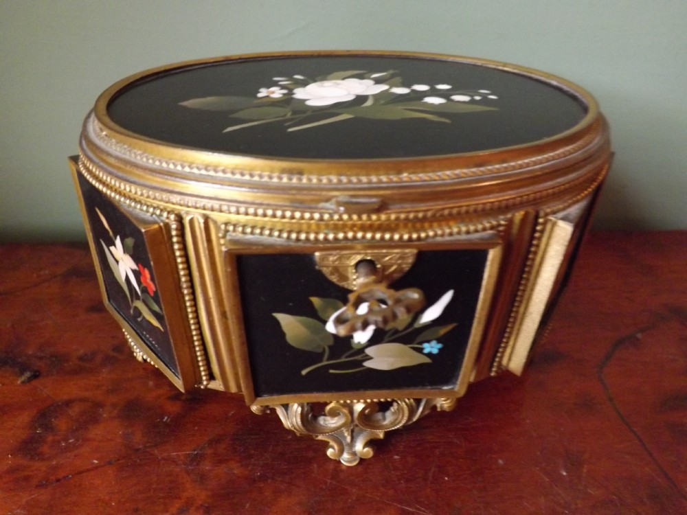 late c19th italian ormoluframed 'pietradura' panelled jewellery casket