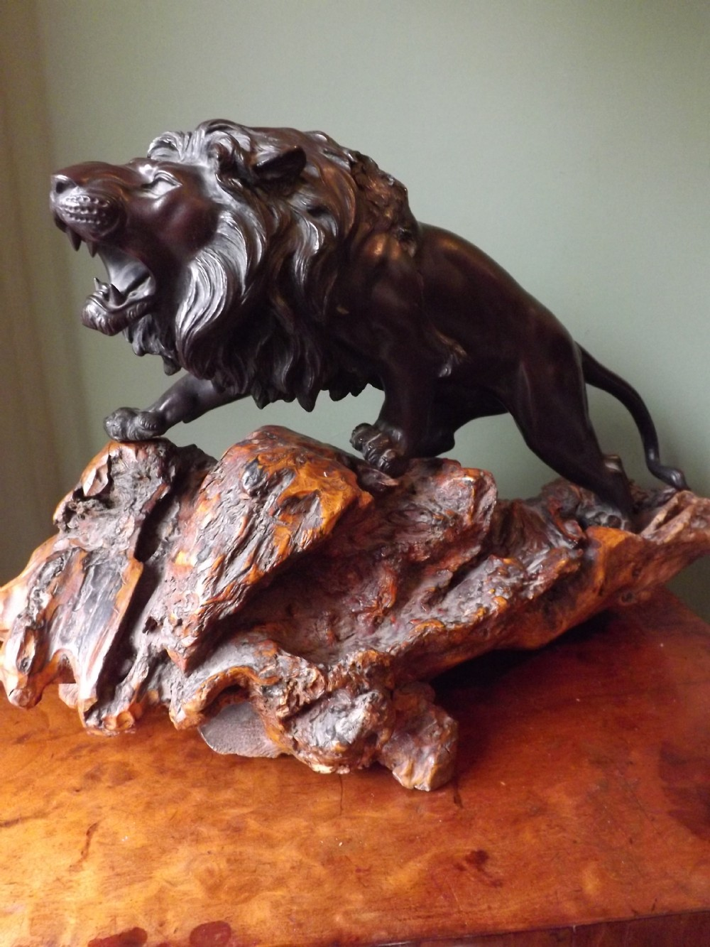 late c19th japanese patinated bronze lion study on carved rootwood stand