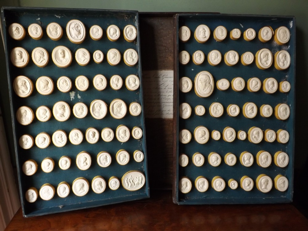 early c19th casedset of italian 'grand tour' souvenir plaster intaglios