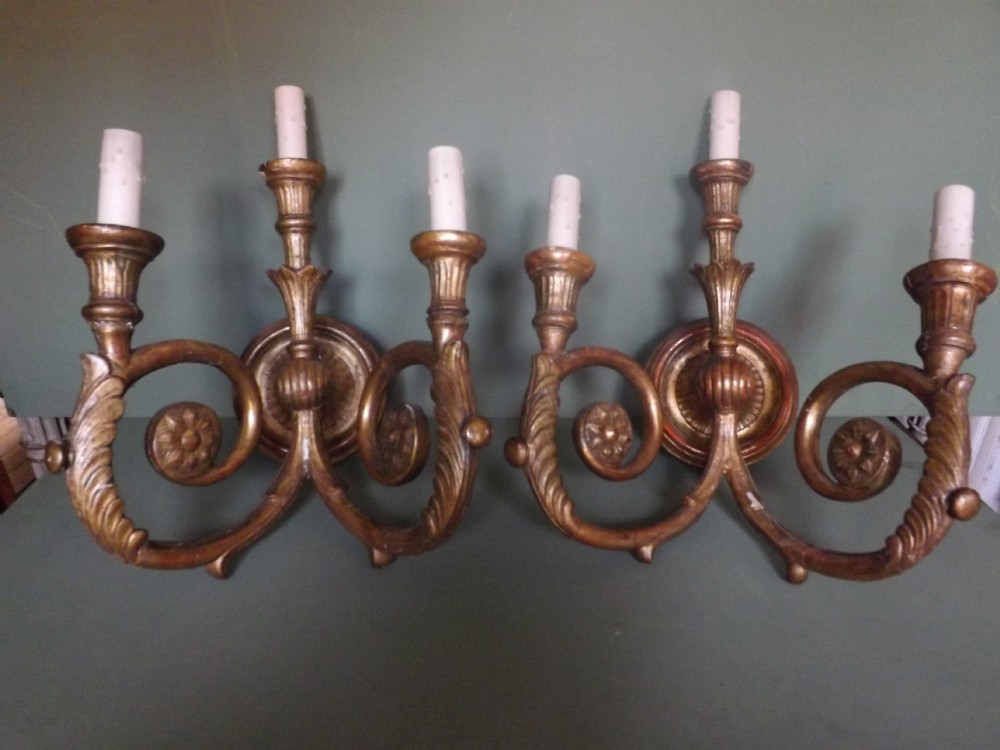 pair of early c20th italian carved giltwood 3 branch walllights