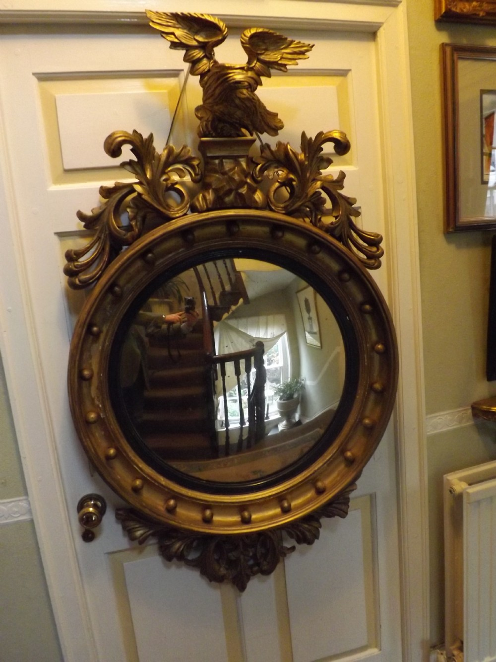early c19th regency period carved giltwood framed convex mirror