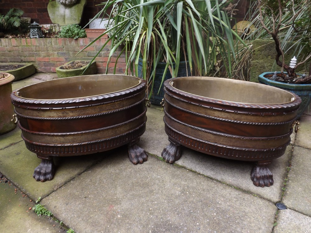 pair of early c20th george ii design periodstyle brassbound oval mahogany winecoolers