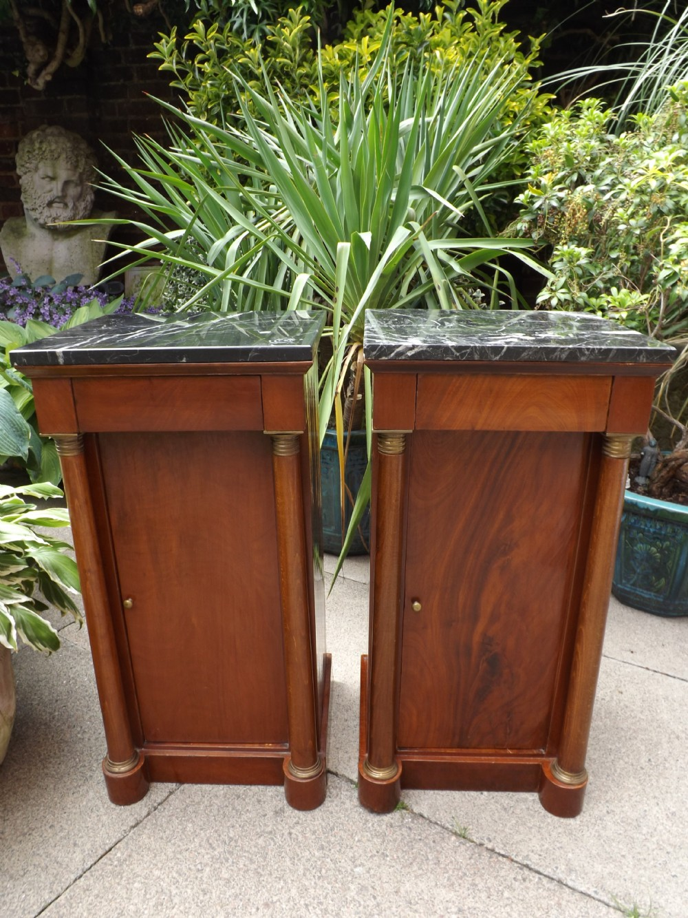 pair of early c20th french empirestyle mahogany marbletop bedside cupboards