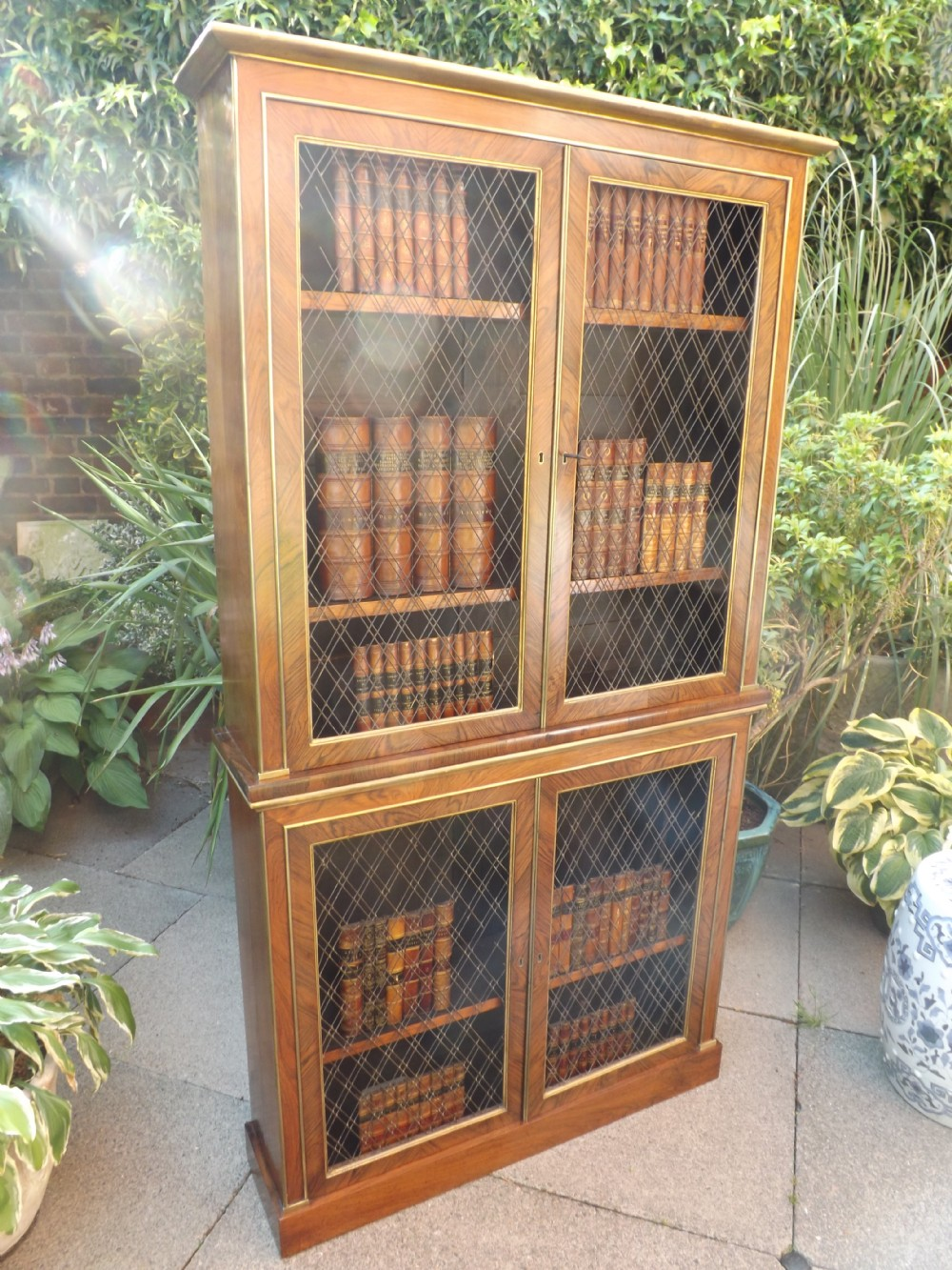 early c19th regency period rosewood gilt brassmounted and parcelgilt 2part bookcase