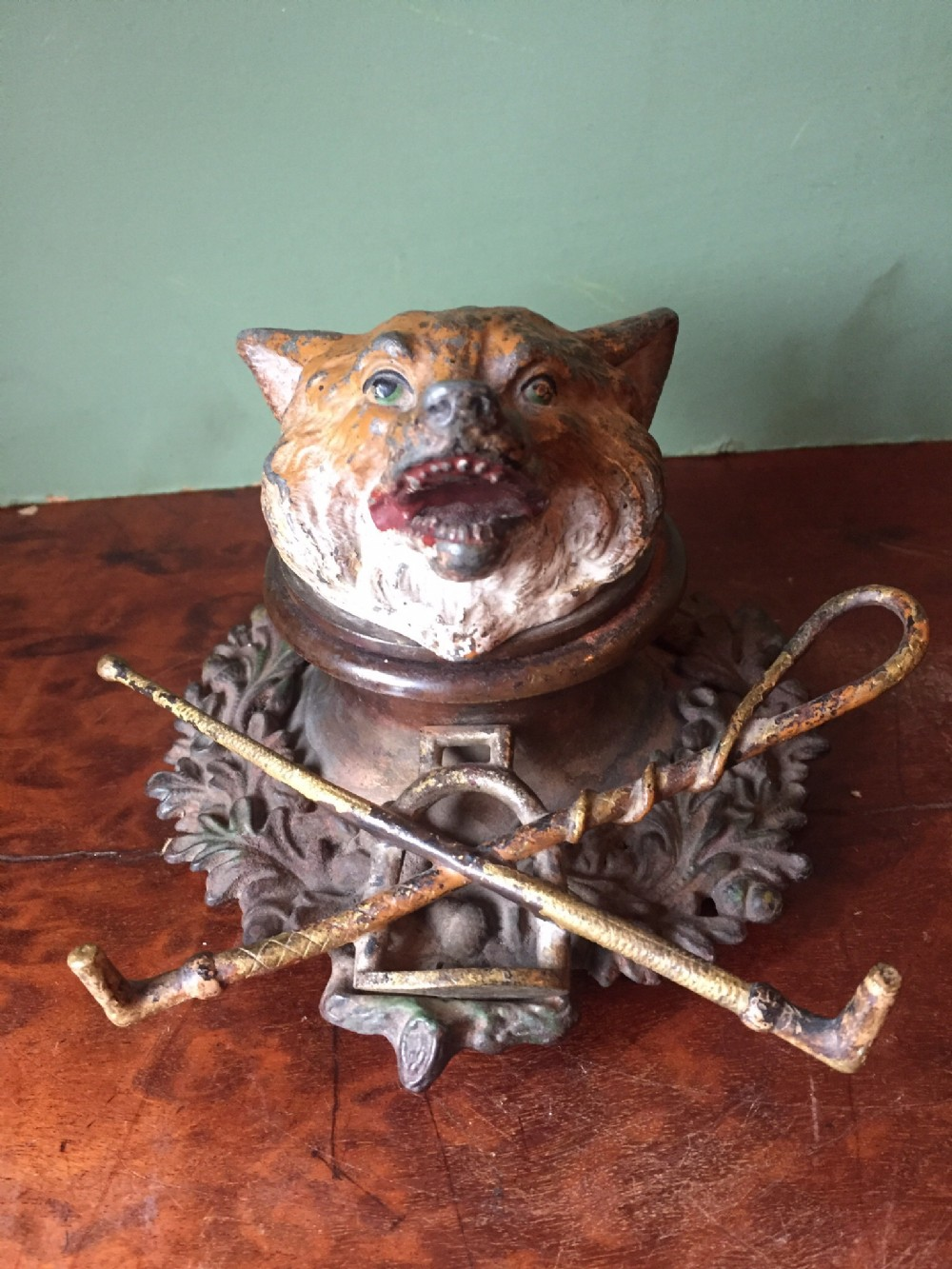 late c19thearly c20th 'coldpainted' cast bronze and brass foxhead inkwell
