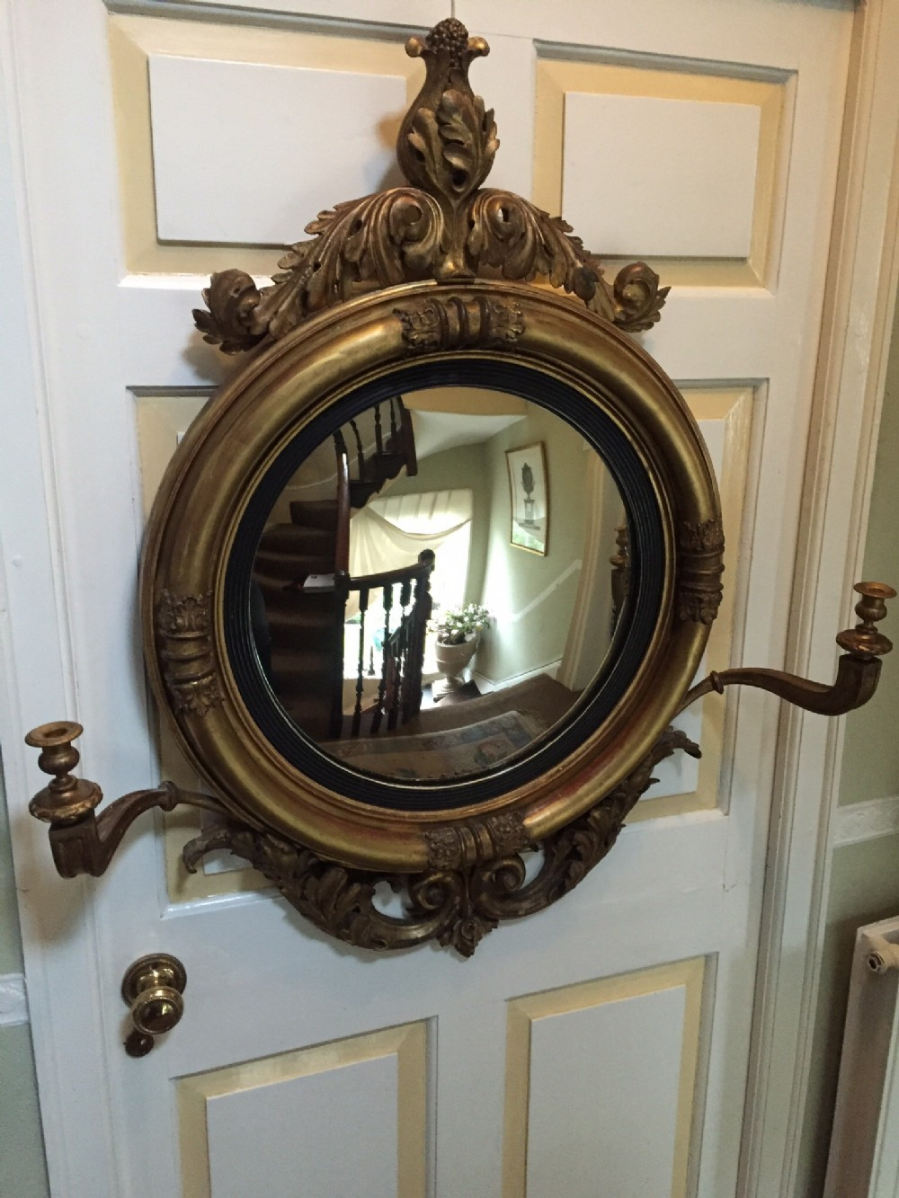 early c19th regency period carved giltwood framed 'girandole' convex plate mirror