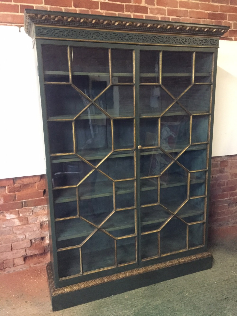 c19th george ii style decorated and parcelgilt astragal glazed bookcase
