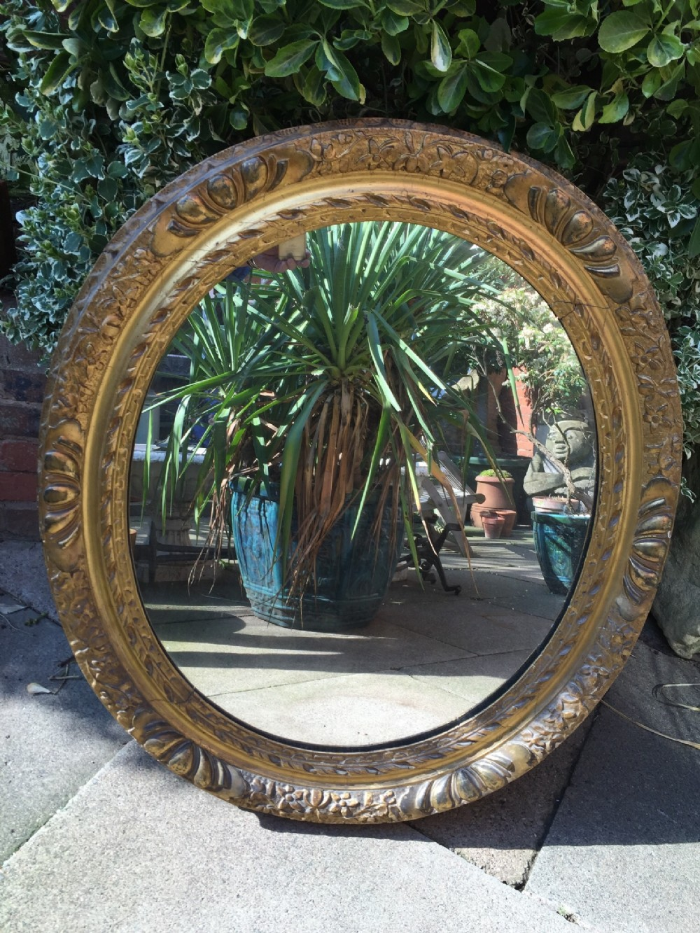 late c18th carved giltwood and gesso ovalframed mirror