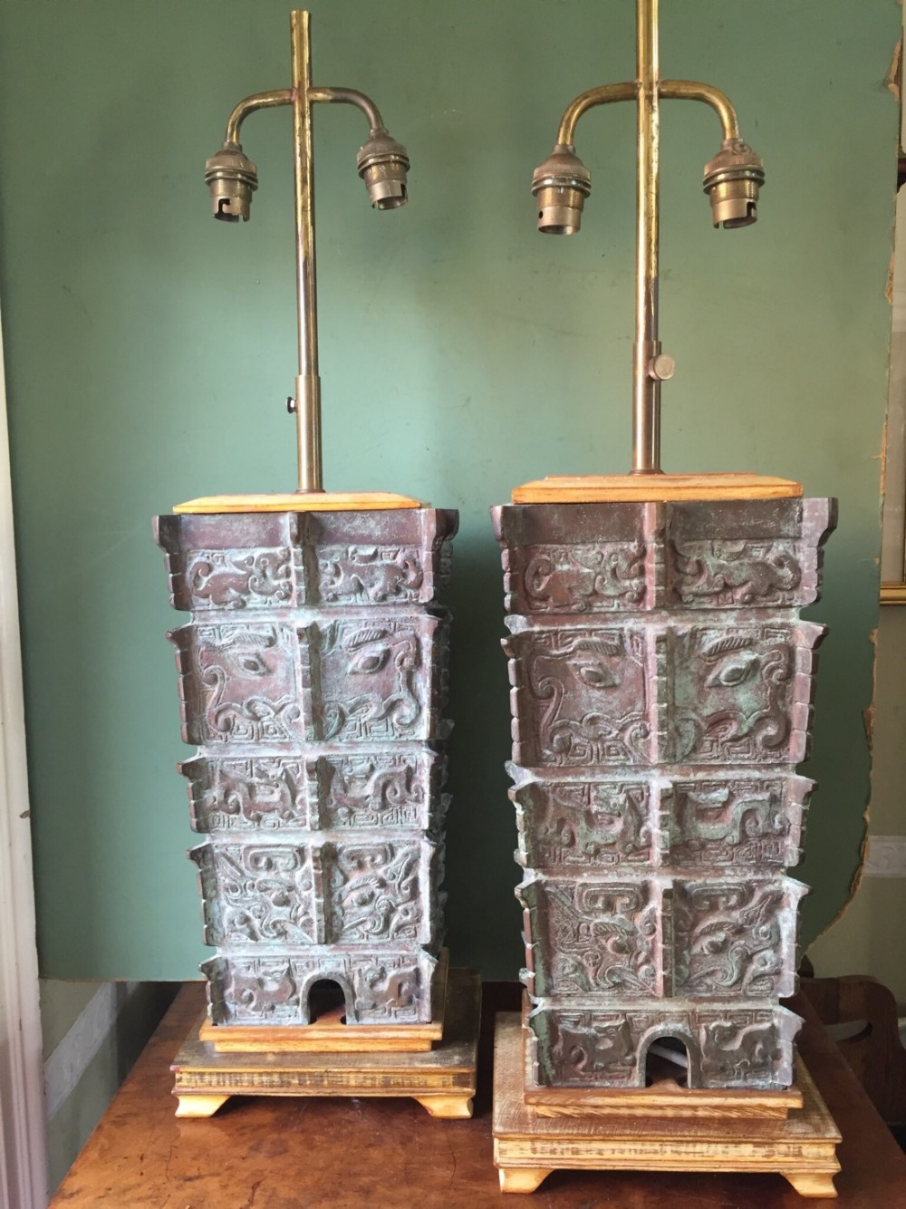 pair of early c20th chinese verdigris bronze lampbases of archaic shang dynasty 'fanglei' design