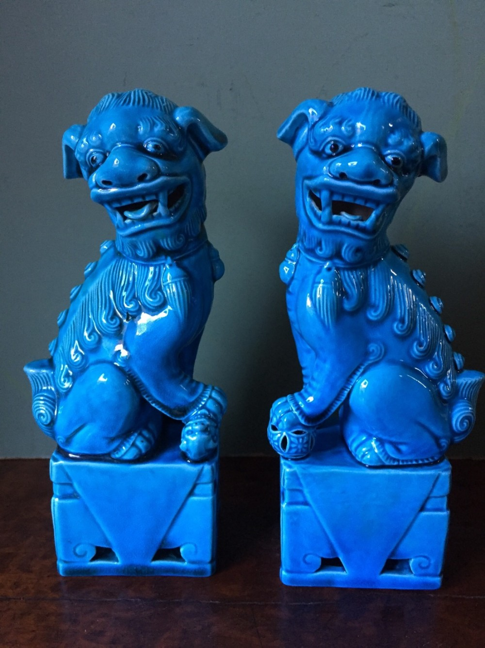 pair of early c20th chinese glazed turquoise pottery 'dogs of fo'
