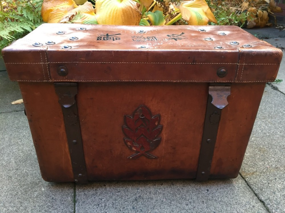 interesting and practical early c20th brassmounted leather trunk or chest