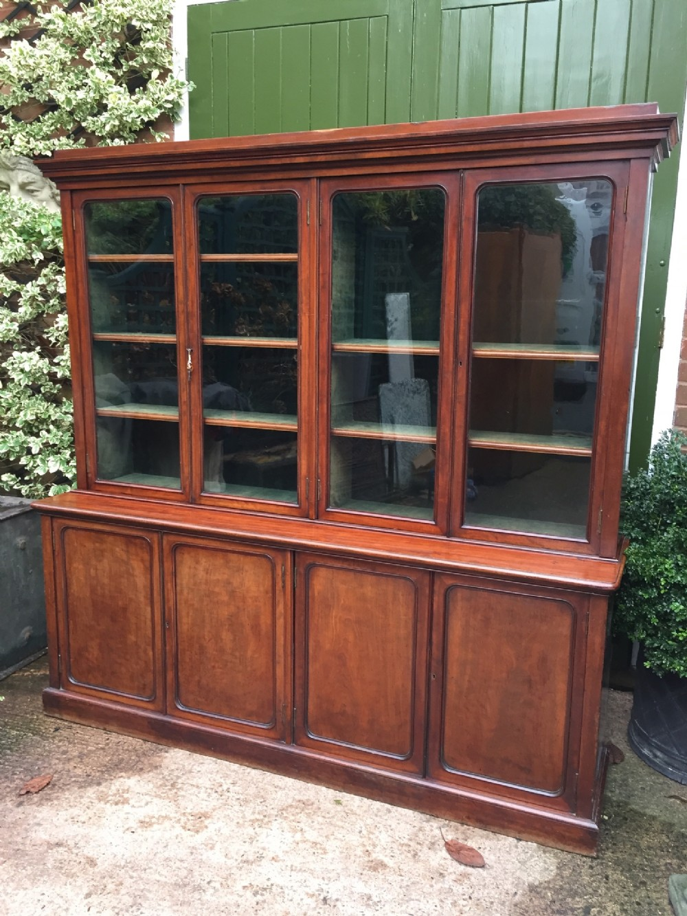 fine quality early c19th mahogany 4door library bookcase cabinet of elegant and compact proportions