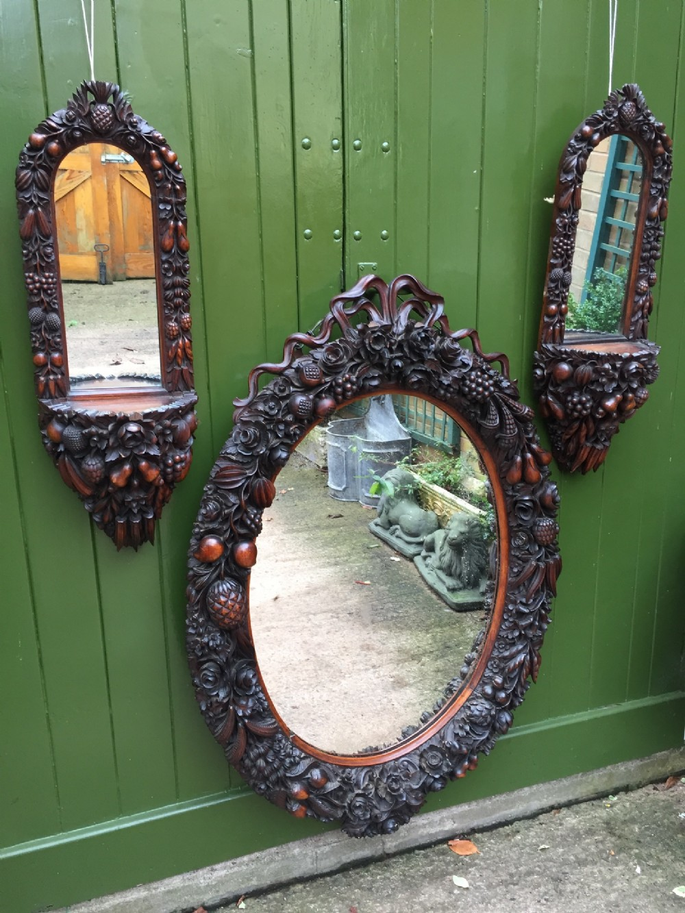 rare c19th indoportuguese carved rosewood garniture of mirrors