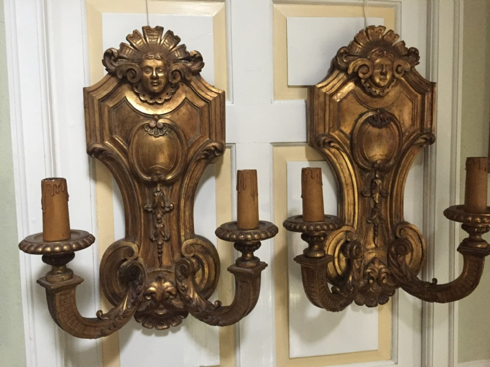 large and impressive pair of early c20th french or italian carved giltwood twin branch walllightsappliqus in the mid c18th louis xv xvi manner
