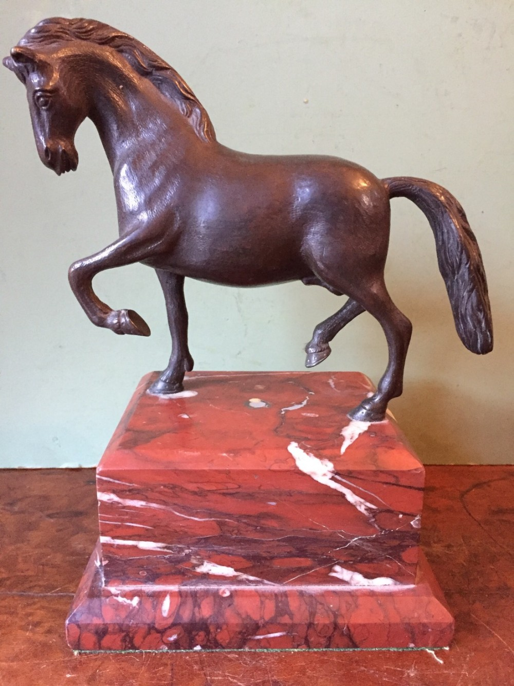 c19th italian bronze sculpture of a prancing horse in the renaissance manner mounted on a stepped rouge marble plinth base