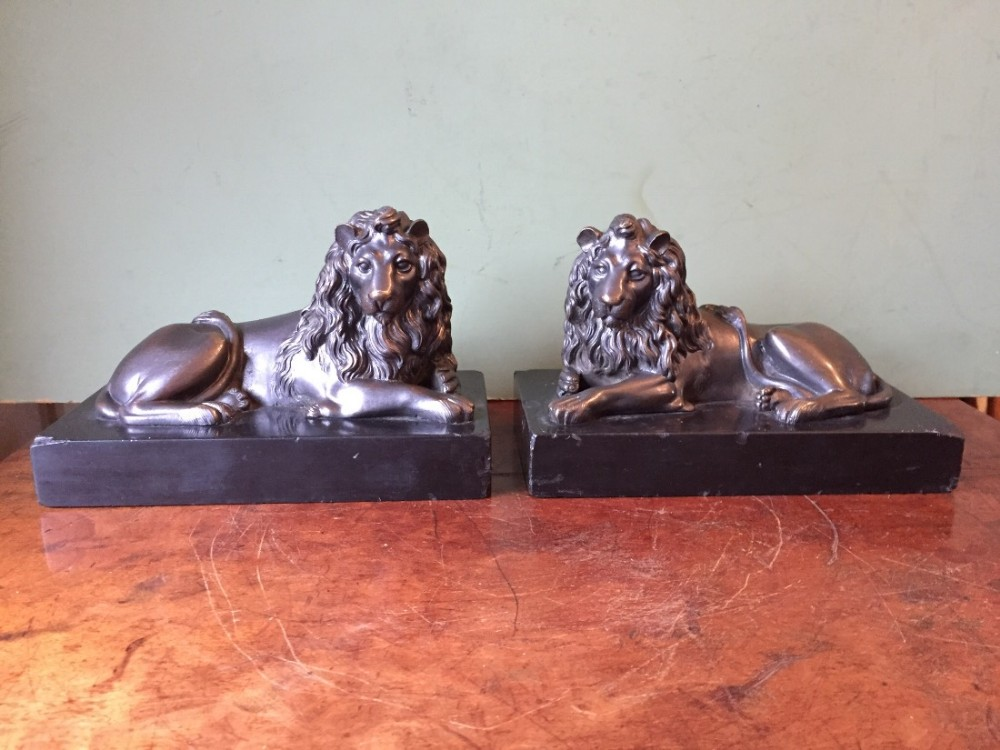 pair of midc19th french bronze lions on original black marble plinth bases