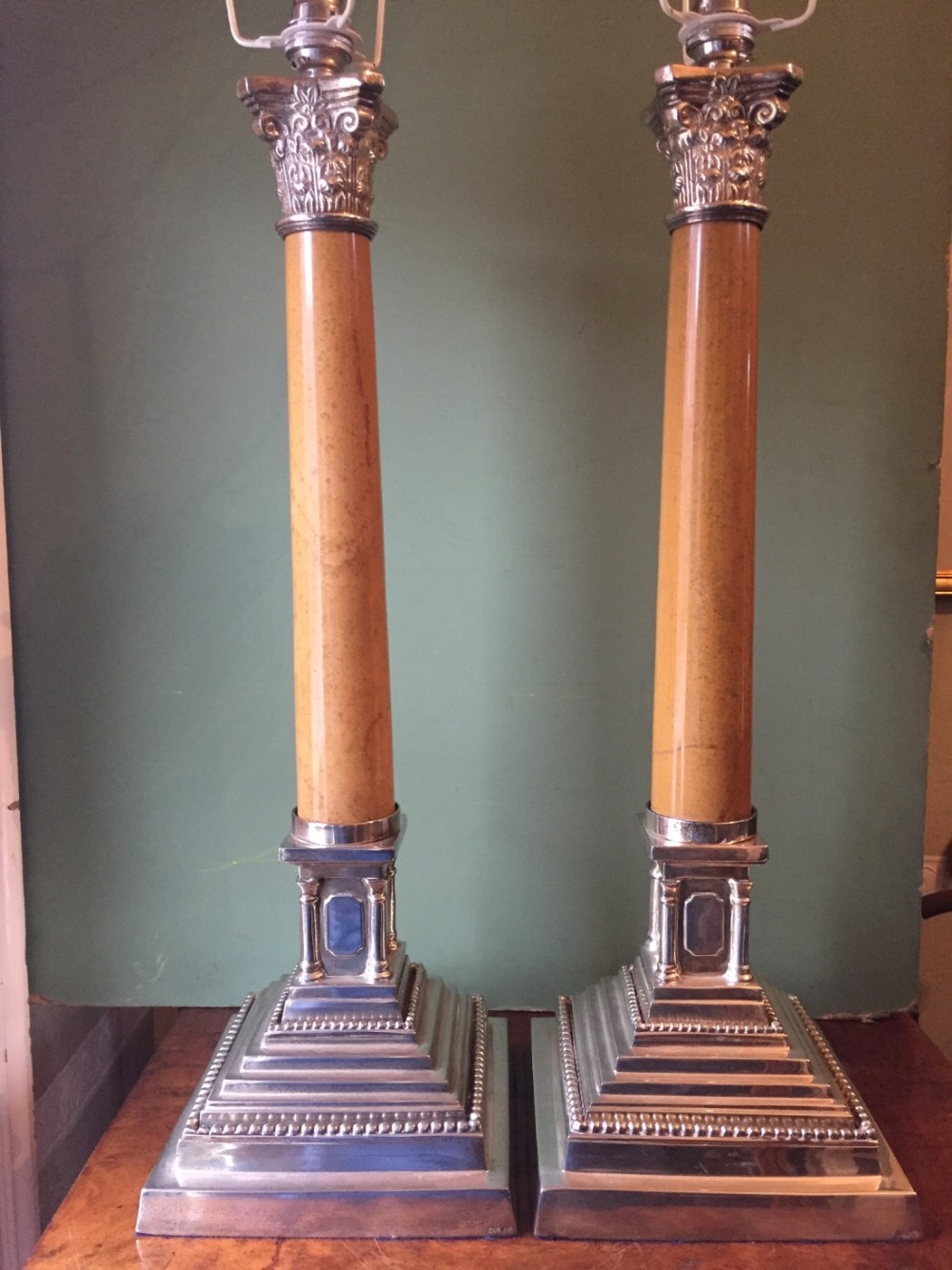 pair of early c20th silverplated and marble column corinthiancapped classicalstyle table lamps