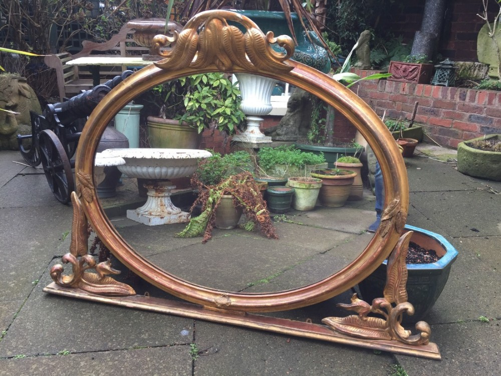 mid c19th carved giltwood ovalframed overmantel mirror with unusual carved fern motif decoration