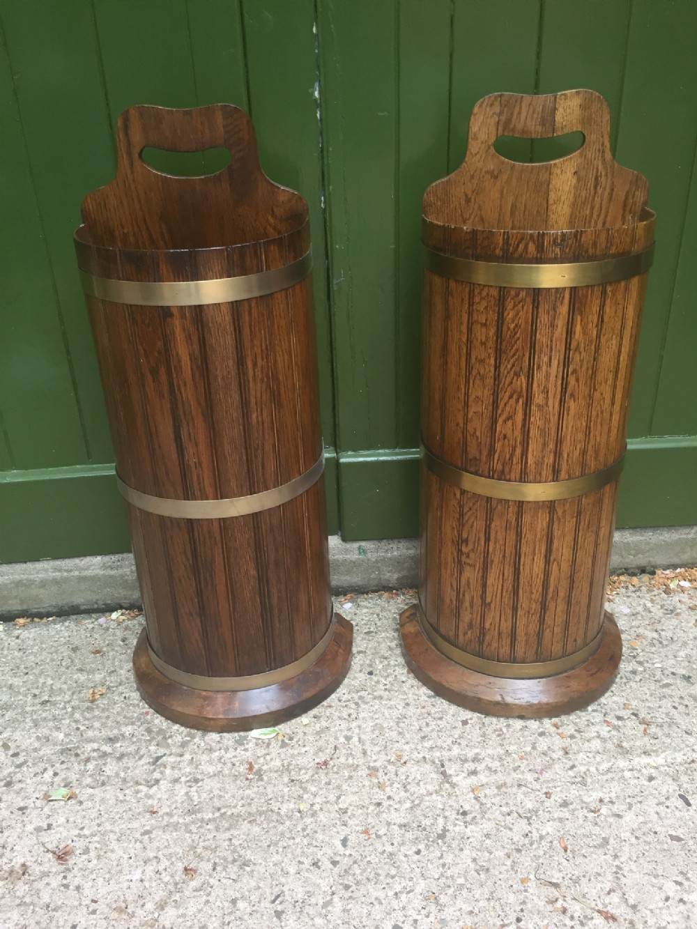 pair of late c19th brassbound oak semicircular umbrellastickstands of 'coopered' construction