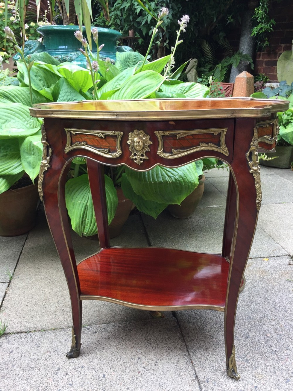 early c20th french giltbrass mounted mahogany and kingwood table of louis xvi design