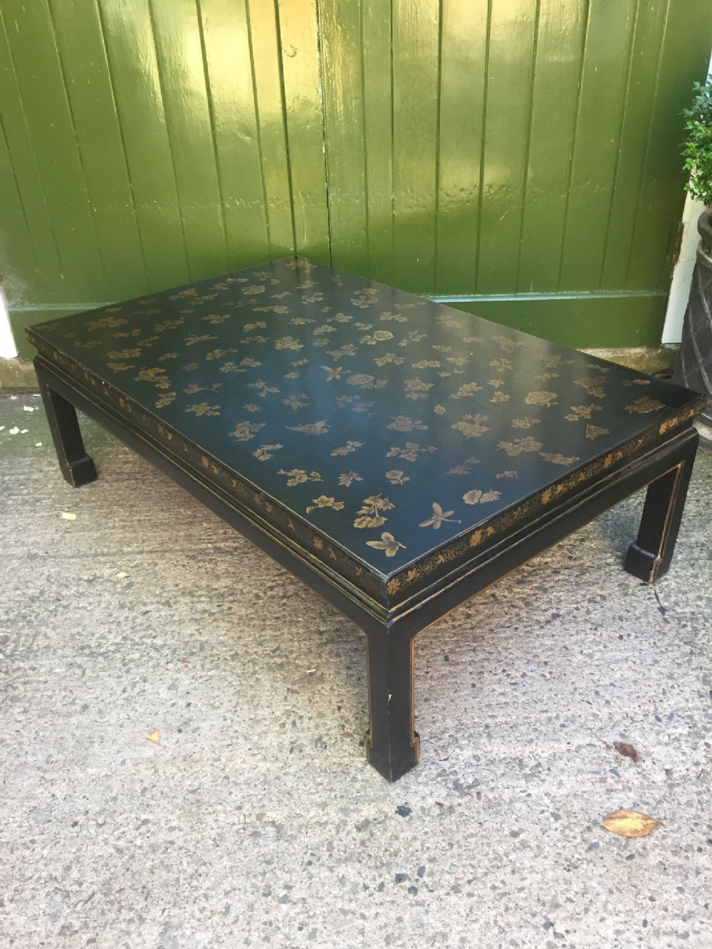 early c20th chinoiserie style black and gold lacquered low coffee table