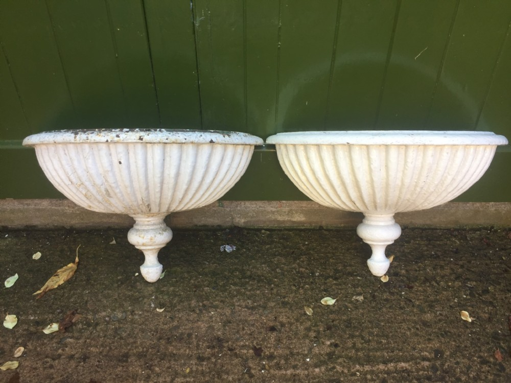 pair of early c19th castiron semicircular wallhanging planters of rare form
