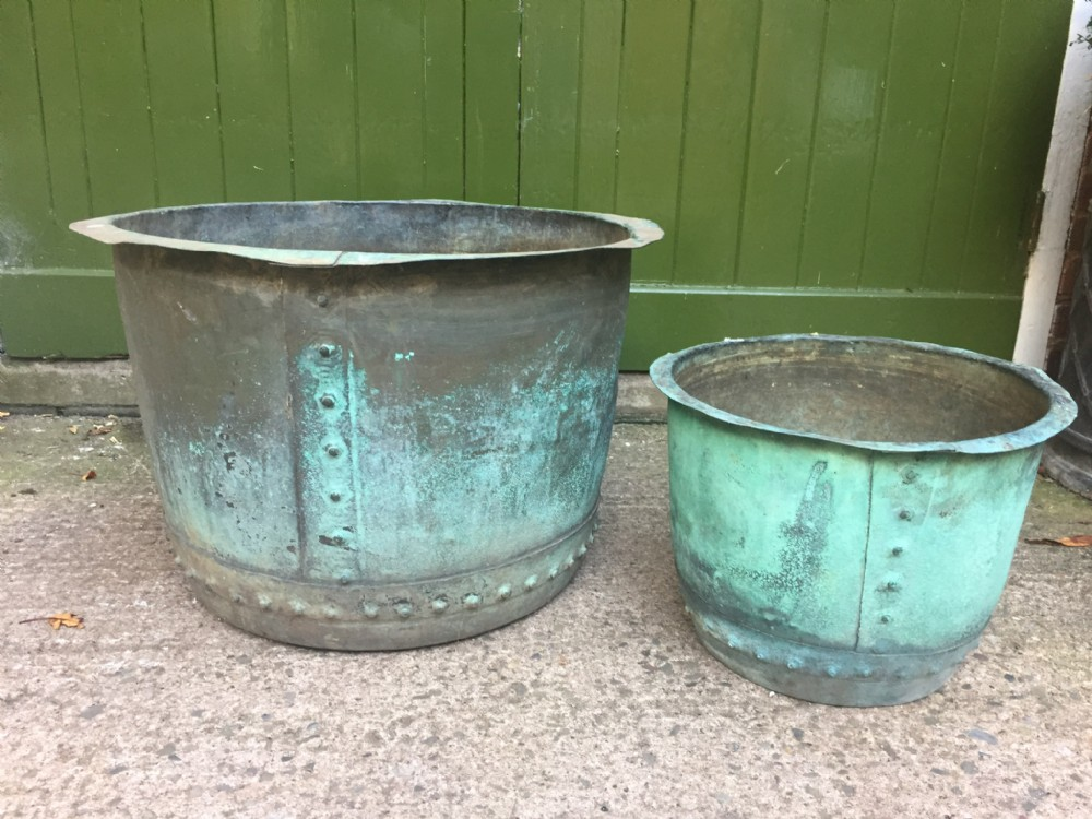 2 late c19th copper 'coppers' of riveted construction with verdigris patination