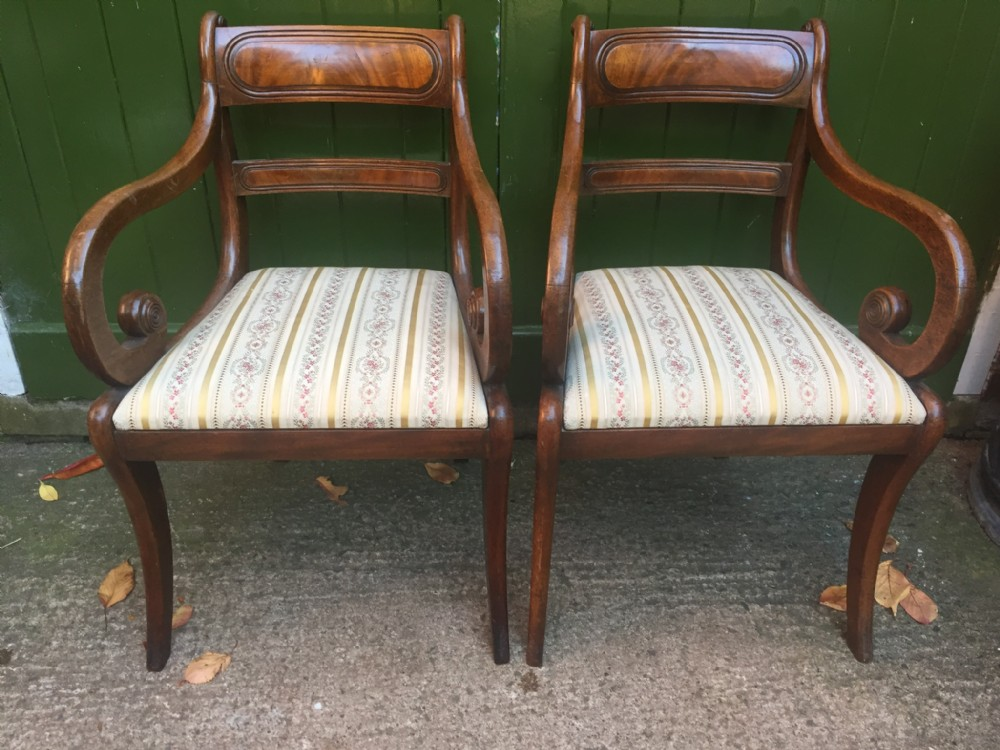 pair of early c19th regency period mahogany sabreleg armchairs