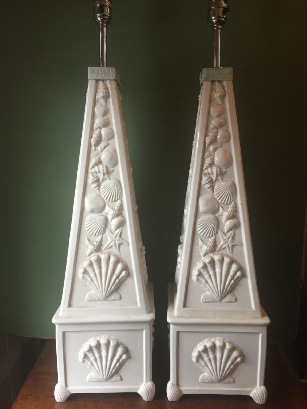 highly decorative pair of early c20th italian pottery lamps of obelisk form with raised 'seashell' decoration