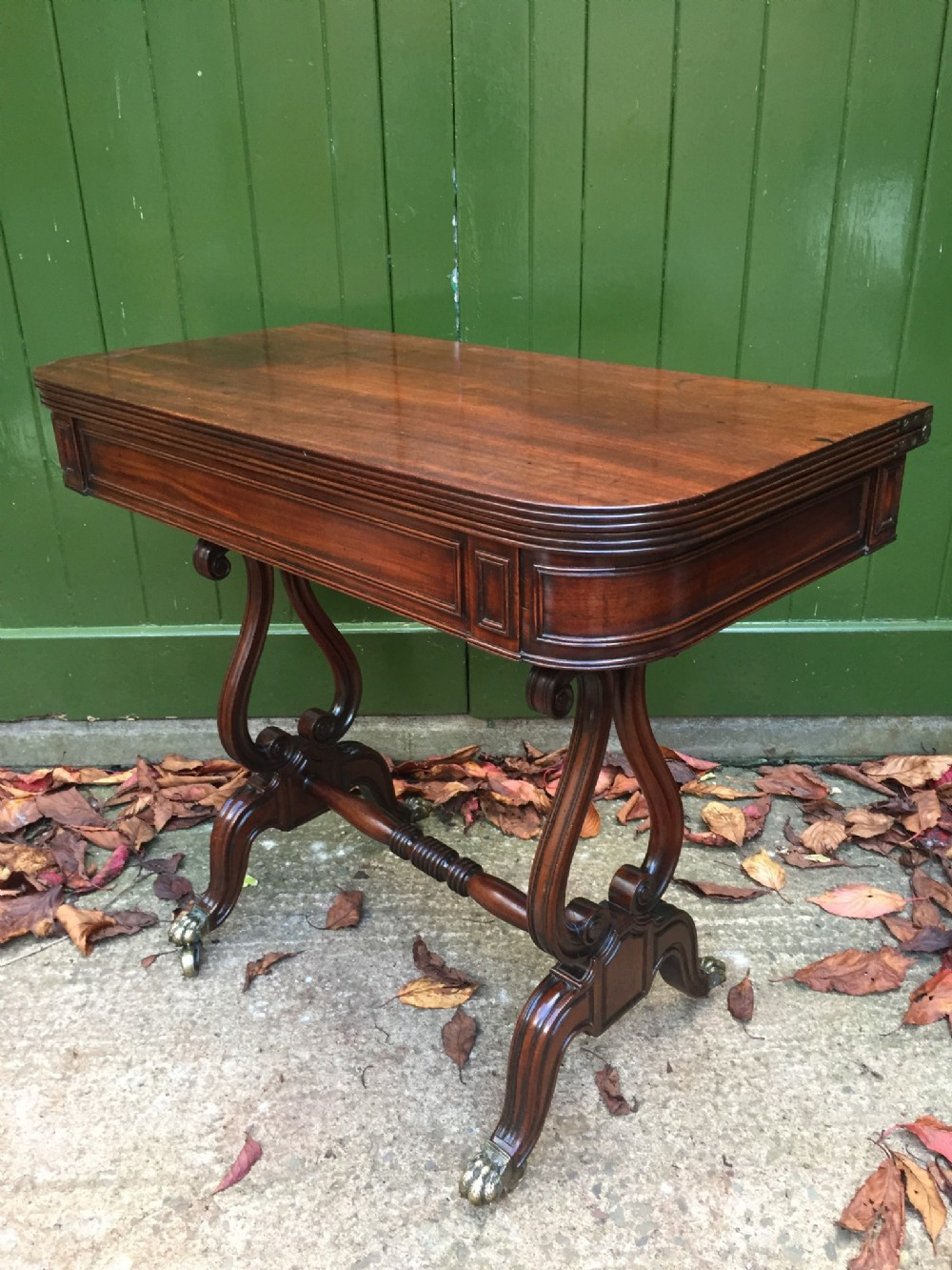 early c19th regency period mahogany foldover top teatable on 'lyre' end supports