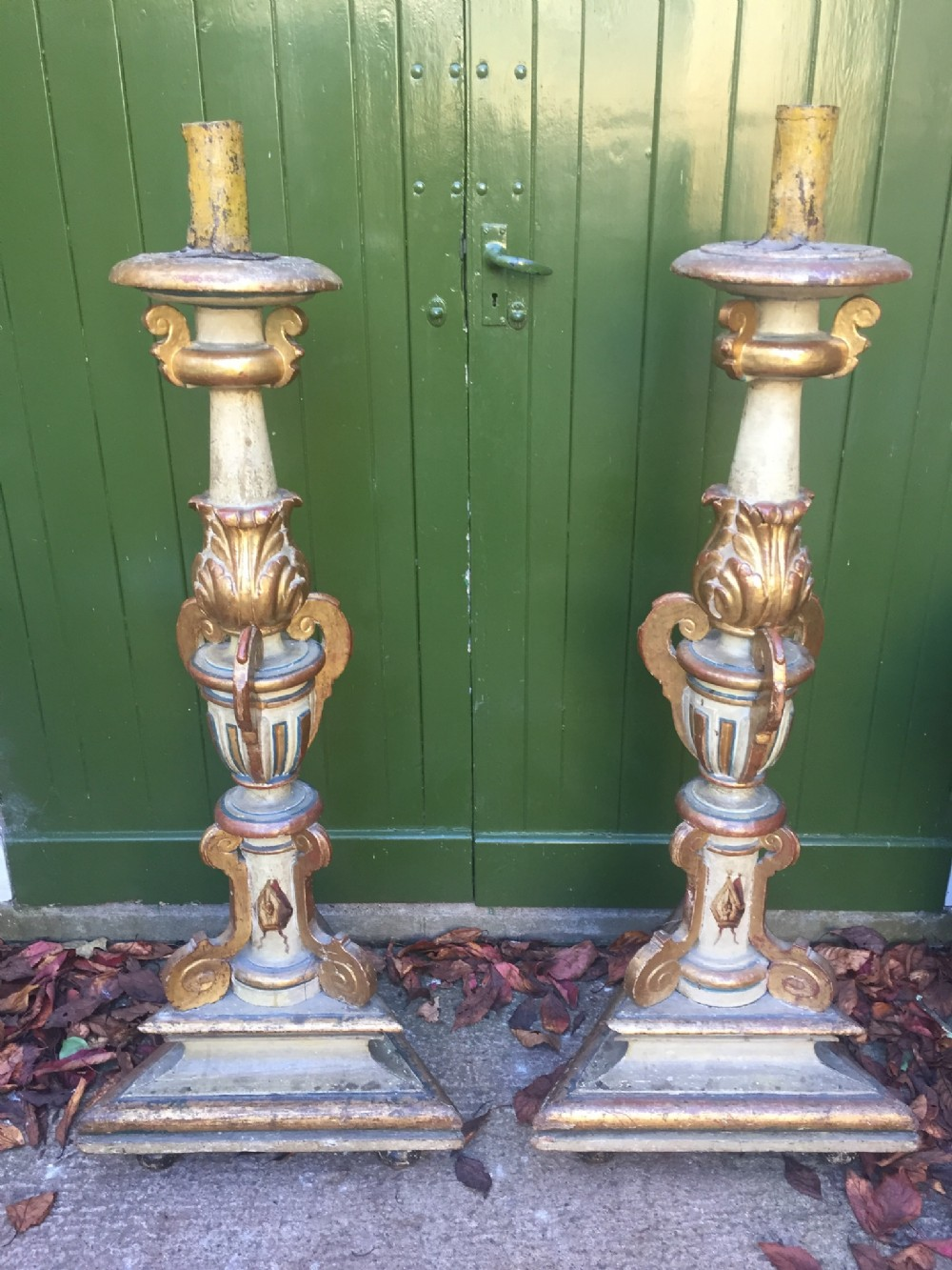 large pair of c18th giltwood decorated baroque style altartype candleholders of impressive proportions