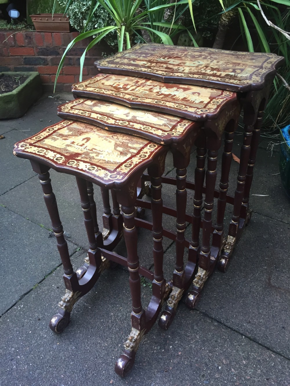 c19th quartetto of chinese export lacquer tables with gilded decoration