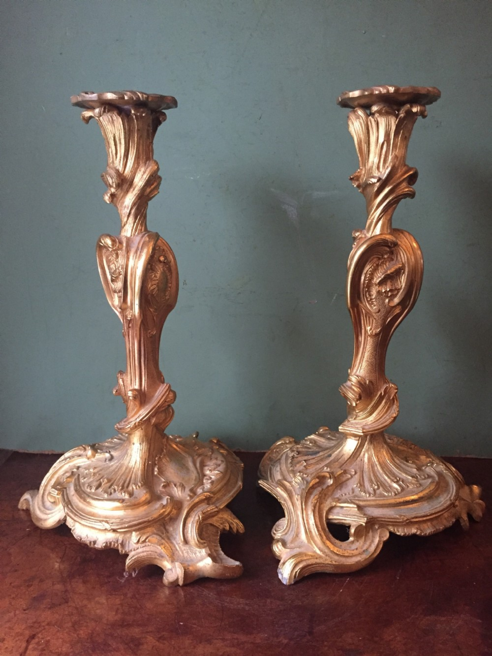 pair of mid c19th french ormolu bronze candlesticks of louis xvi rococo design