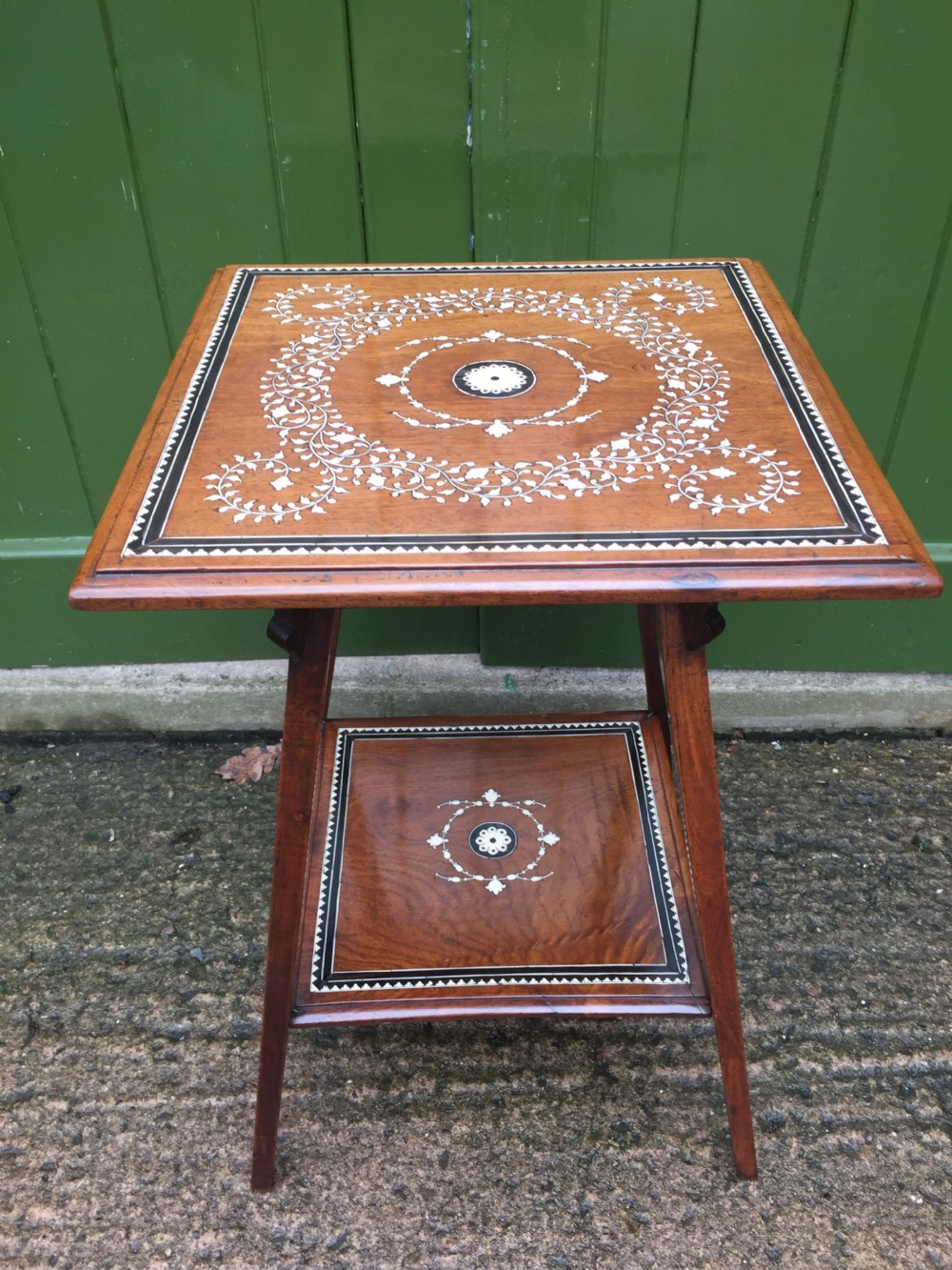 late c19th angloindian twotier teak lamp table with ivory and ebony design inlay