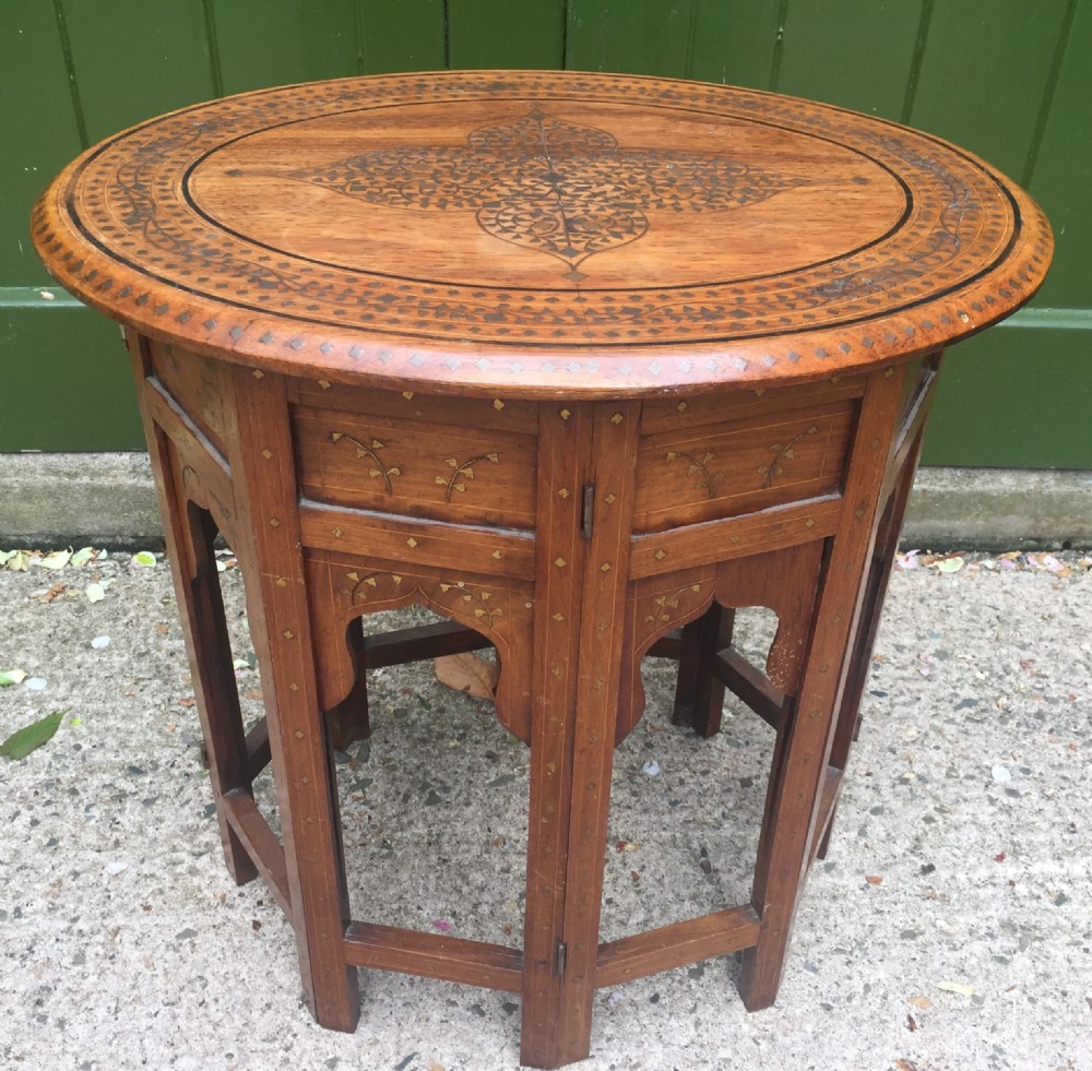 late c19th indian brassinlaid oval teak occasional table on folding arcaded base