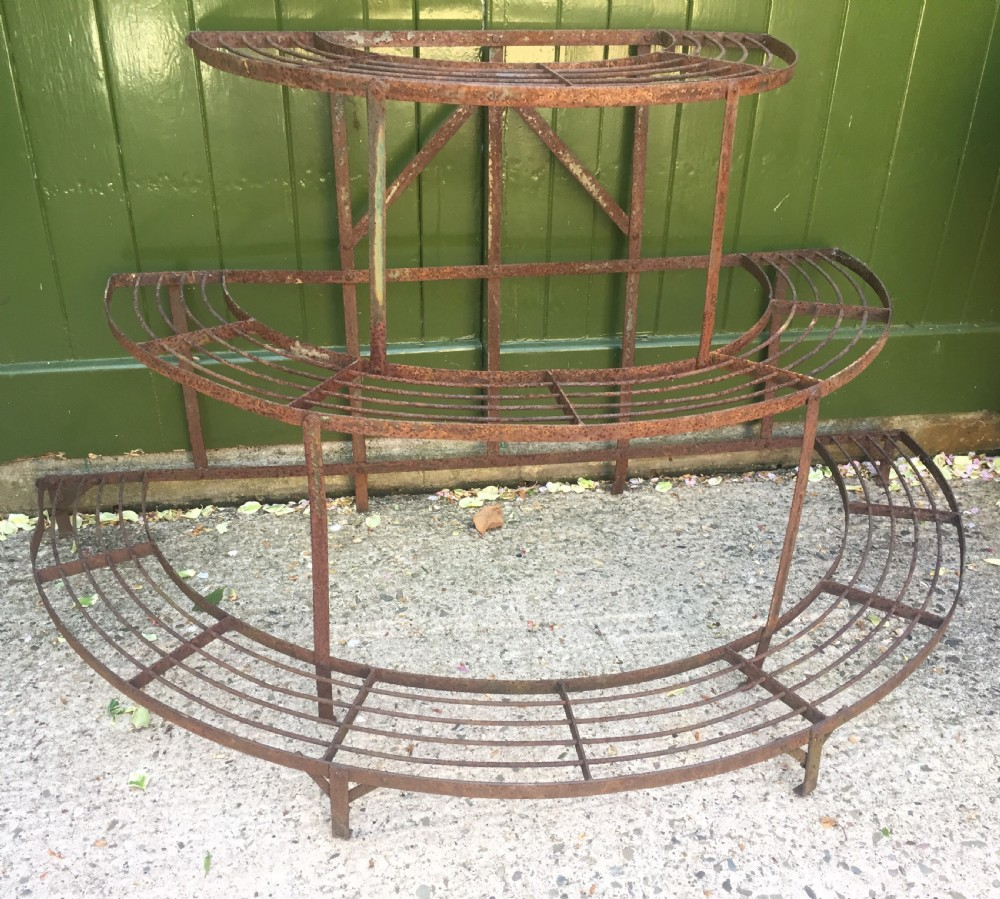 late c19th early c20th slatted wroughtiron conservatory orangery or garden plant stand of semicircular graduated form
